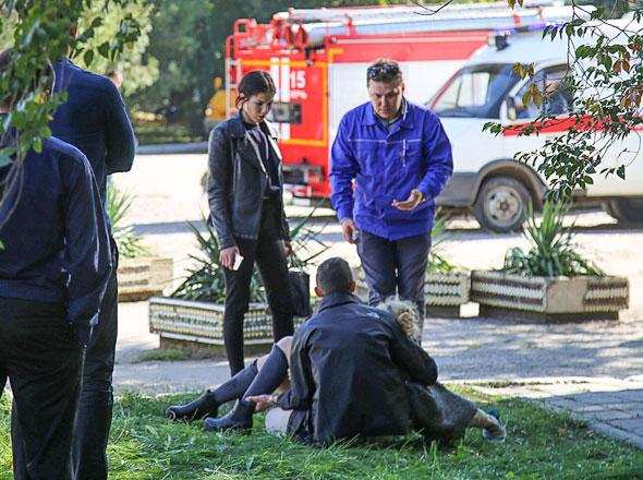 A rescuer carries an injured victim of a blast at a college in the city of Kerch on Wednesday