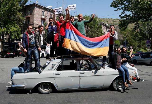 Supporters of Armenian opposition leader Nikol Pashinyan drive a car during a rally in Yerevan Armenia on Wednesday