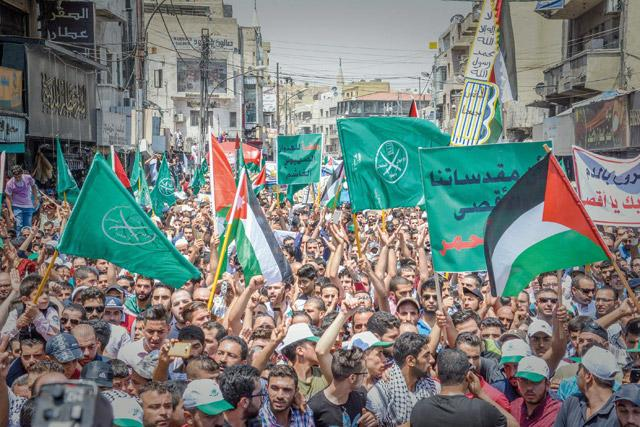 Demonstrators march in Downtown Amman to protest against Israeli measures in occupied Jerusalem on Friday