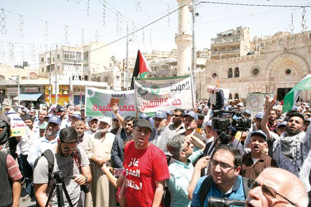 Jordanians take to streets to protest Gaza massacre, US embassy move