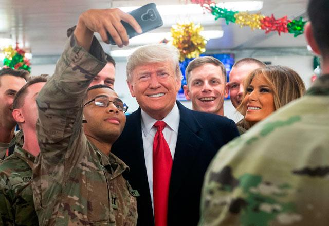 Donald Trump visits US troops in Iraq for first trip to a conflict zone