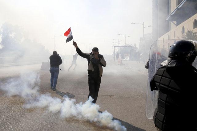 Clashes in Baghdad as thousands protest against government
