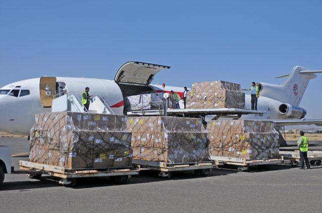 Workers unload aid shipment from a plane at the Sanaa airport Yemen on Friday