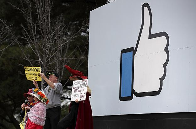 Facebook to verify identities, require labels for political
